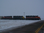 A Trio of ex-SP GP35's Lead a Few Grain Hoppers in a Light Snow