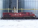 CP 9562 Idles Near the Grain Elevator