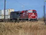 An Idle CP Doublestack Train Waits to Fully Enter the US