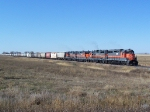 DMVW Grain Train Rolls Over the Prairie