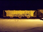 A CSX COVERED HOPPER CAR SITS IN MILLVILLE RAILROAD YARD ON A COLD WINTER'S NIGHT