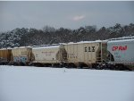 HOPPER CARS SIT IN THE SNOW
