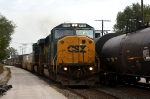 An ex Conrail SD60M leads Q135 west after meeting S386
