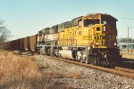 Loaded coal train speeds east