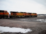 BNSF 5347 4486 1074 eb at head of mile long string of covered hoppers