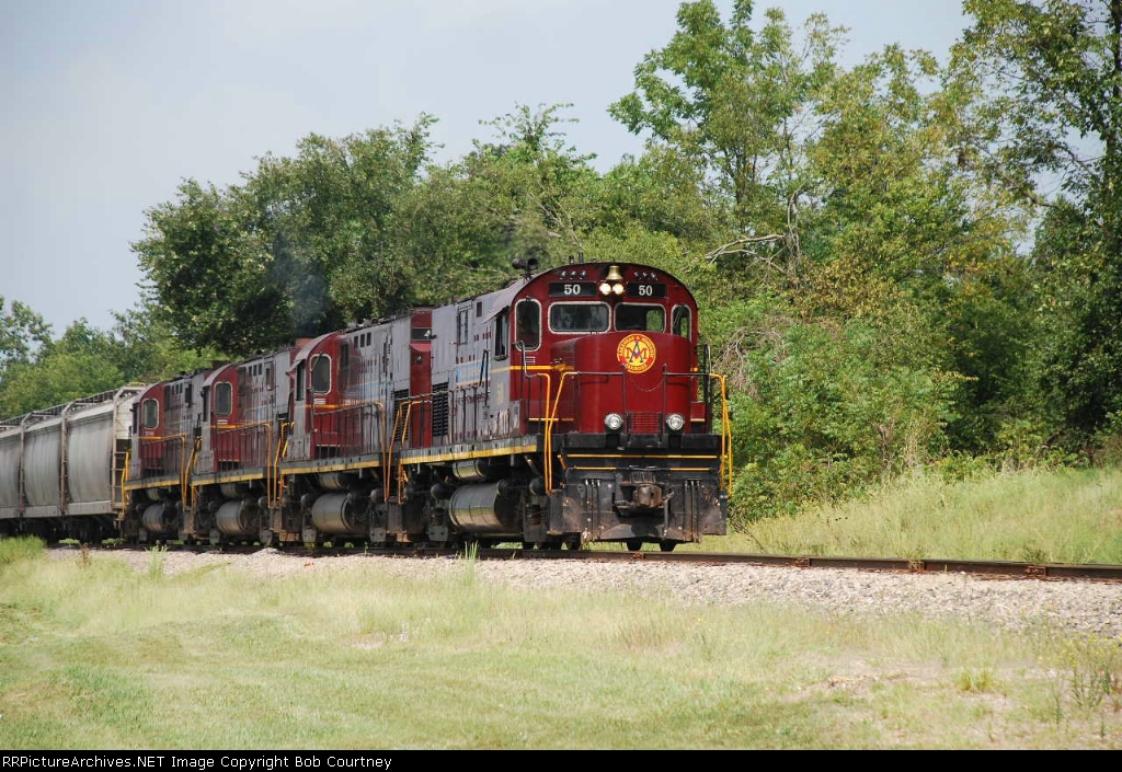 AM 50 leads the Monett Turn south (unusual for non-db C420s to lead the turn)