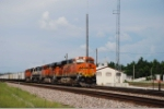 BNSF 6083 rolls a coal empty past the yard office