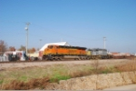 BNSF 7589 and a grey SD40-3 wait to head west