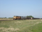 UP 5987 and a TFM SD70 roll coal empties west