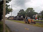 NS K06 (LHF) *long hood forward* local train approaches pass a rest of Case backhoe and, Front St.