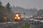 NB BNSF baretable in the pouring rain