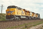 Westbound stack train behind three brand new GEVOs