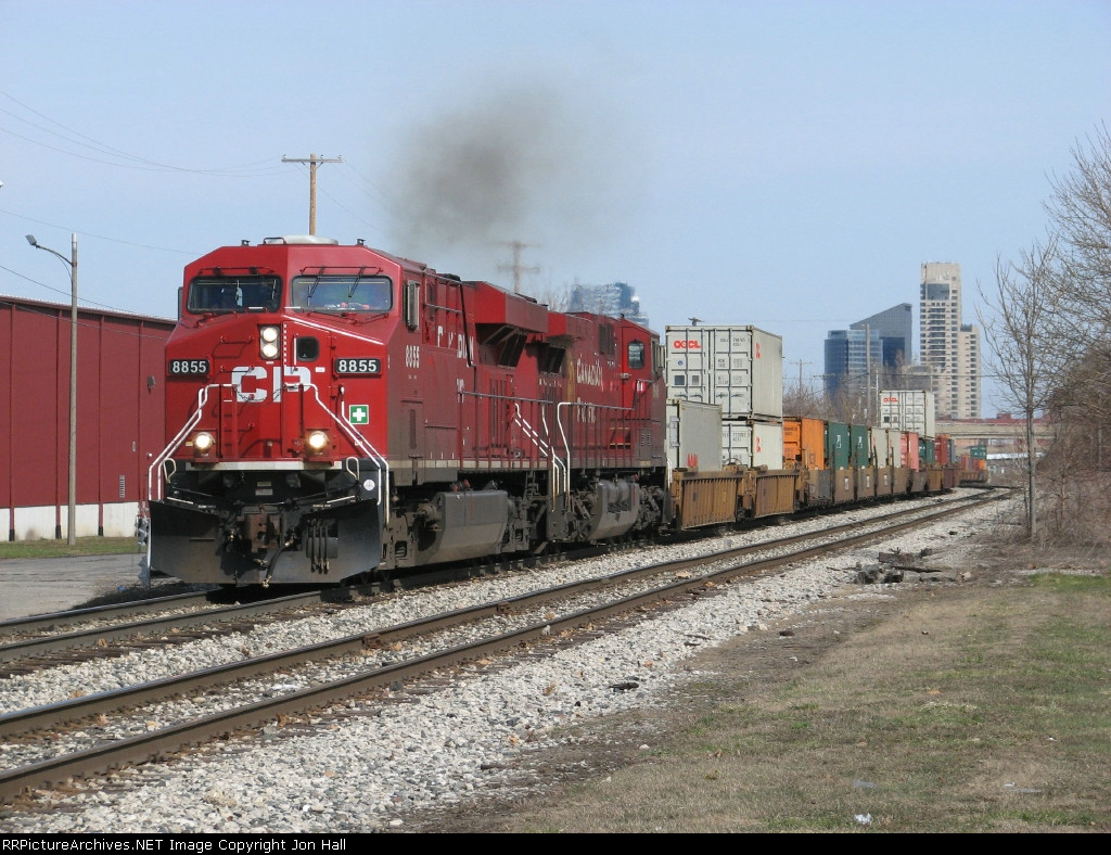 CP 8855 & 9646 leads a solid train of single and double stacks east as X500-26