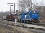 GMTX 2648 leads Z151-11 southward out of the Grand Rapids Yard Limits