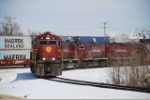 The Monett Turn leaves the yard headed south as westbound stacks roll on the main