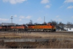 BNSF 7491 and a pair of older cosuisn roll stacks east