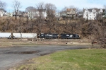 NS H65 continues east on Wash. Sec on ex-DL&W tracks behind the remains of the old Phillipsburg CNJ Yard