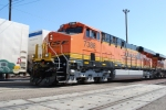 BNSF 7388 waits to roll west with a new crew as another train passes by on Main track 1 at the BNSF Needles depot.