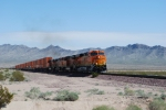 BNSF 7388 pulls the grade leading the ZKCK-SBD stack train as she heads west towards Goffs, California and further west towards Barstow, CA.
