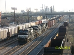 NS 9025 leads train 341 south past CSX train 579