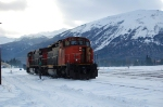 A old good SD40-2w at Jasper East end with a big mountain behind.