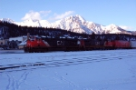 beautiful Sunset with tje Pyramide Mountain in December with this CN train passing the Jasper VIA station.