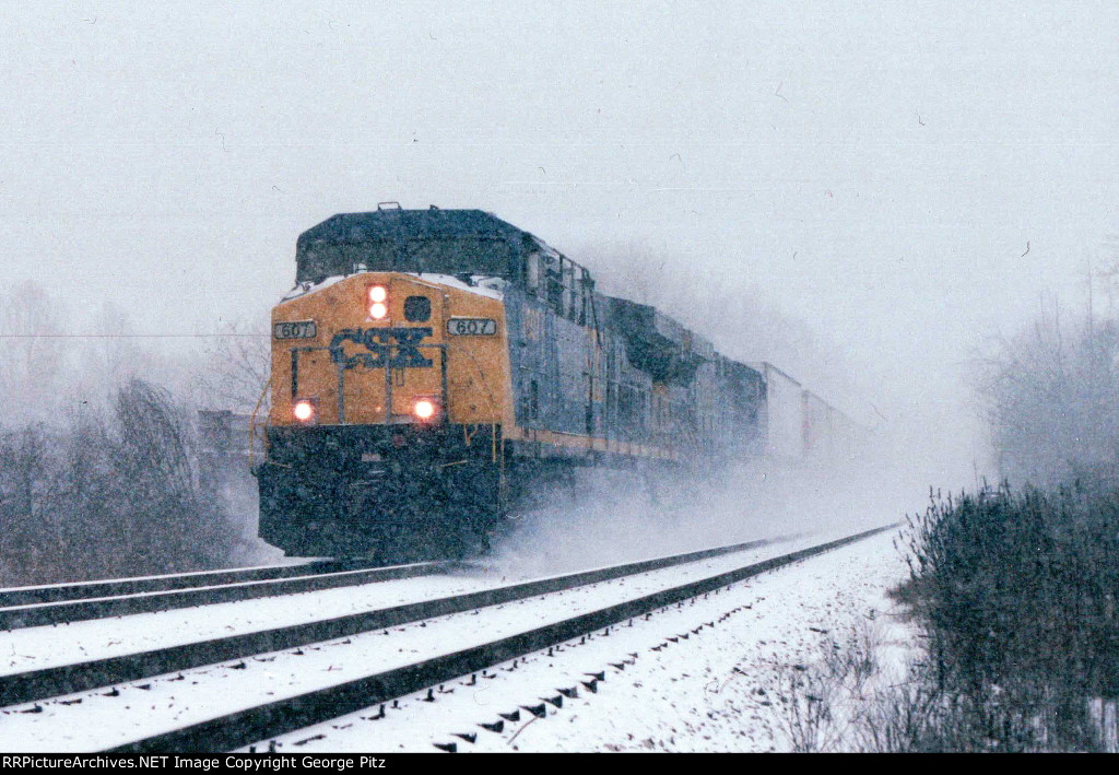 CSX 607 comes out of the snow