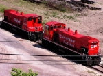 CP 1422 & 1429 (MILW Road 486 and 483) bask in the Muskego spring sun