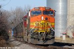 BNSF 4944 & BNSF 8208 lead empty ballast train.