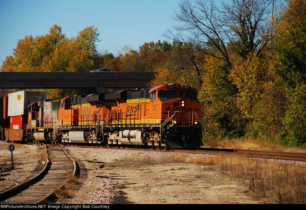 The Trees echo BNSF's orange as another stack train pulls onto Main 2.