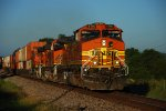 BNSF 4180 charges into the morning sun.
