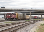 CP 5612 pulls a cut of autoracks out before doubling them over to another track