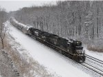 B09 heads west with steel traffic behind NS 8804 & 8906
