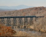 The Amtrak Cresent running very late makes its way across the James River Trestle on NS tracks.  Blue Ridge Mountains in the background