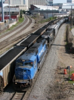 Two SD60 varients lead a NB mixed freight past Jones Ave