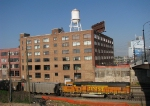 Somewhat clean H2 SD70MAC howls past the Giant Lofts.
