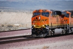 Close up of BNSF 6604 as she makes the curve heading west with a Brand new BNSF 7808 as the 2d unit.