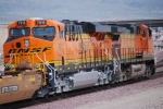 BNSF 7810 rolls into the BNSF Barstow Depot behind BNSF 5145 as they both pull a load of empty container cars east.