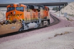 BNSF 7810 with a red over green light approaches the Hwy 58 bridge over the rail as she goes east into the BNSF Barstow Depot.