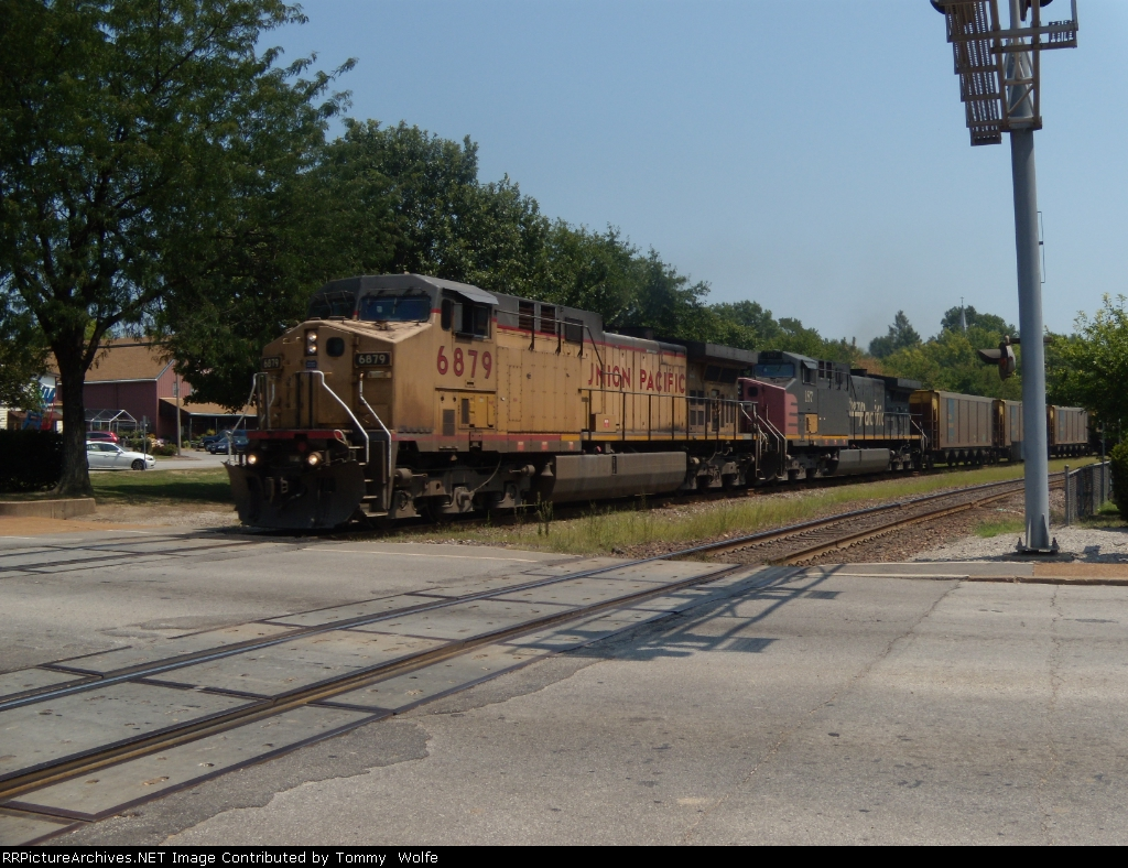 UP 6879 leads an empty coal westbound