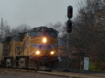 UP 6040 leads a loaded coal just east of the Kirkwood Amtrak Station