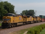 UP 7360 leads a westbound intermodal as it passes the Rochelle Railroad Park