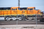 BNSF 7329 and BNSF 7362 both with their cab doors ajar sit on the siding at the BNSF Fresno yard