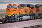 Close up of a Very Clean BNSF 7329 2d unit behind BNSF 4010 pulling a mty spine car consist West.
