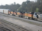.CSX 8521 leads a GE mate ahead of BNSF units on a combined Hyundai and Kia loaded autorack train at Montgomery, AL