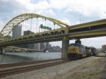 CSX 336 leads an auto train west as it passes under the Fort Pitt Bridge