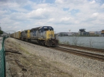 CSX 8048 pushes on the rear of an autorack train as Heinz Field looks on across the river