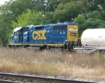 CSX Geep leads off Asplundh weed sprayer train as it sits in the transfer track with NS at Opelika