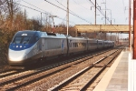 Acela flys past the station heading west