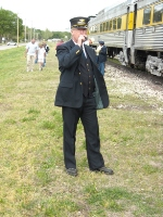 Conductor Jim McKeel on the radio preparing to put the train on a spur
